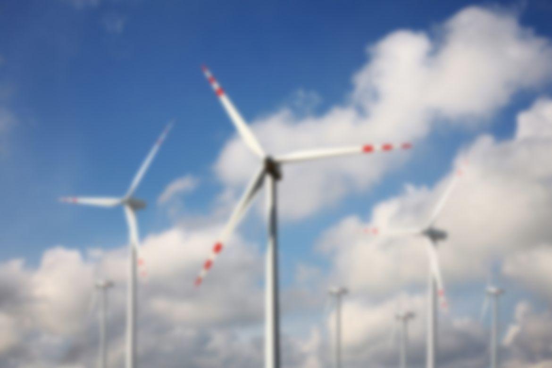 Wind power - wind turbine against the blue sky
